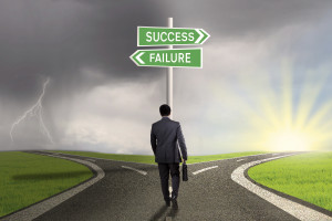 Male worker walking on the road and find two signpost with two choices to success or failure